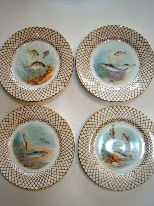 click to view larger image of A beautiful set of four hand painted Limoges bone china fish plates circa 1900