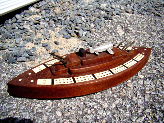 click to view larger image of Possibly unique early 20th century bone inlaid cribbage board in the form of a Battleship with deck mounted plane.