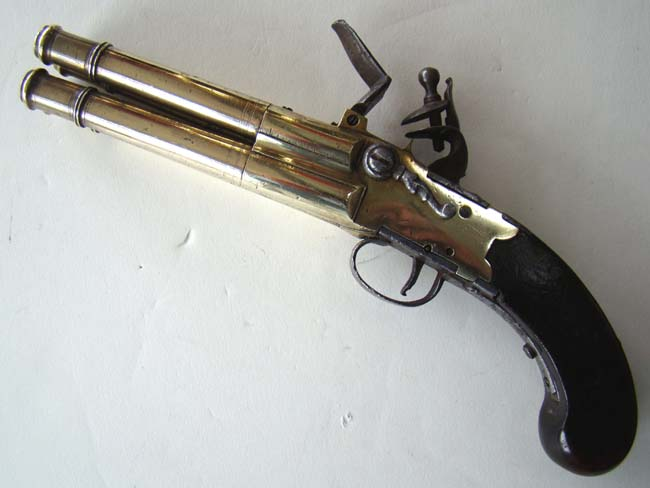 click to view larger image of A Unique large 18th century brass barrel tap action four barrel flintlock volley pistol