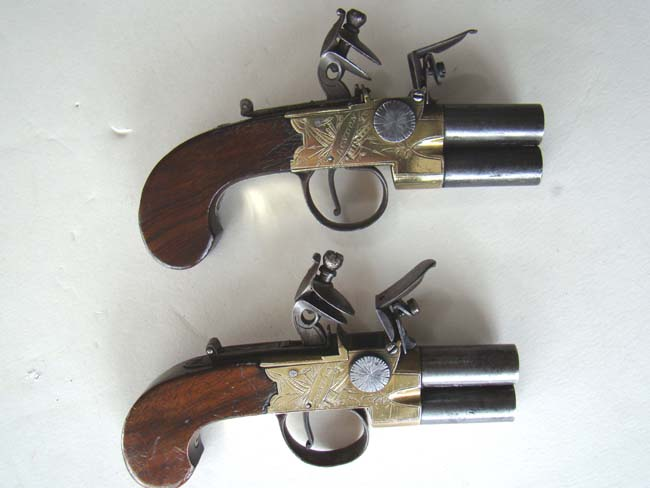 click to view larger image of A fine pair of Henry Nock double barrel brass frame flintlock pocket pistols circa 1775-1785