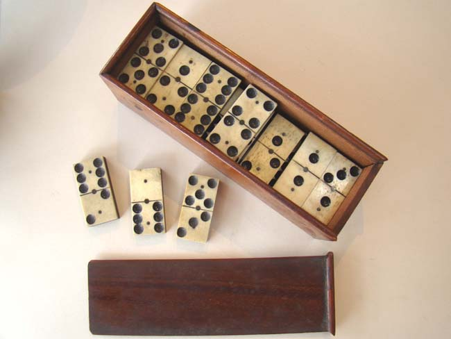 click to view larger image of A fine boxed set of Civil War bone and ebony dominoes circa 1865
