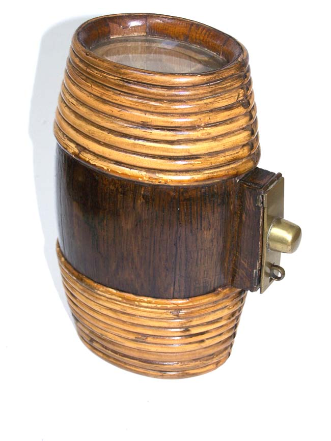 click to view larger image of An antique whiskey flask or keg with rattan wrapped ends circa 1890-1900