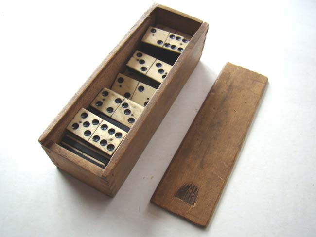 click to view larger image of A nice boxed set of Civil War era bone and ebony dominoes circa 1860-1870