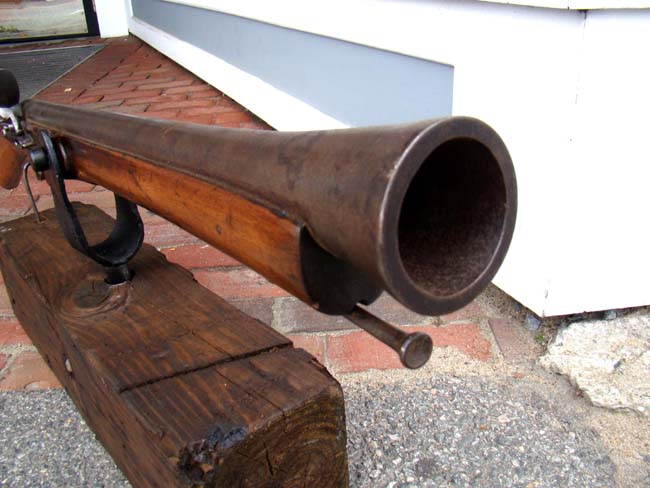 click to view larger image of A late 18th or early 19th century steel barreled flintlock blunderbuss with swivel mount