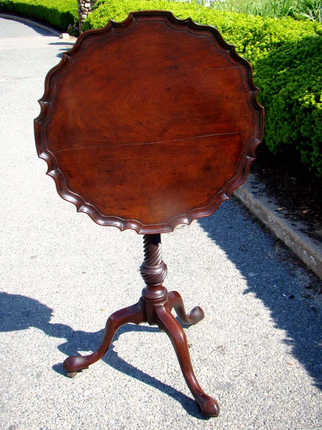 click to view larger image of A George III period Mahogany Tilt-Top Tripod Table with Piecrust top and birdcage support circa 1760