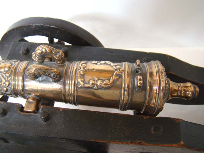 click to view larger image of A wonderful 17th century Dutch bronze barreled salute cannon with original painted carriage