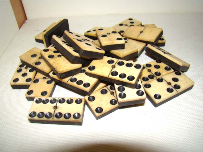 click to view larger image of A complete set (28 pieces) of Civil War era circa 1865 bone and ebony dominoes