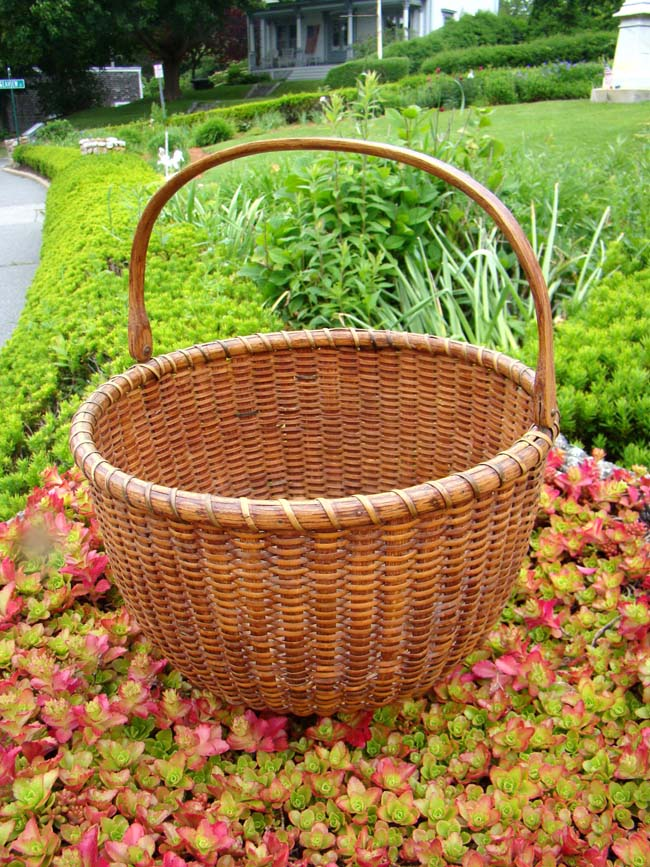 click to view larger image of A very fine NANTUCKET 'swing handle' basket made circa 1880.