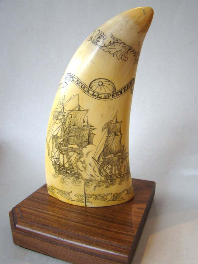 click to view larger image of A very nice reproduction scrimshaw whale's tooth made by Artek
