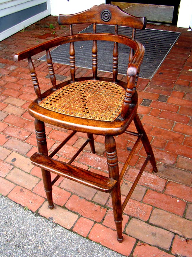 click to view larger image of A charming19th century child's high chair with rattan seat circa 1860-1890