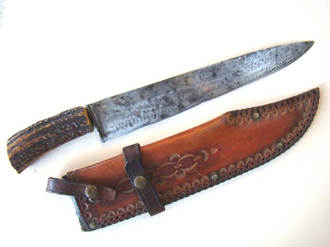 click to view larger image of A stag horn handled hunting knife with its' original leather sheath