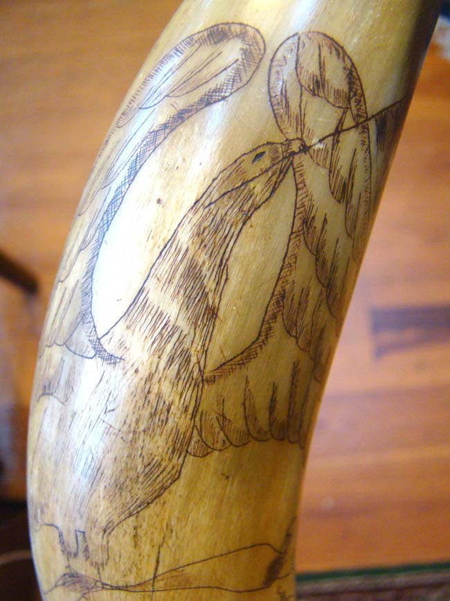 click to view larger image of A rare and unbelievably beautiful American polycrome decorated and sailor carved patriotic powder horn circa 1810-1830