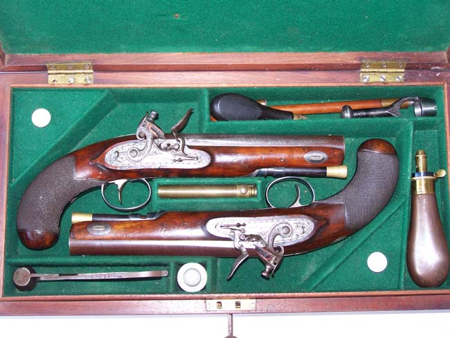 click to view larger image of A Cased pair of English Flintlock 'Gentleman's' Traveling Pistols by Thomas Mortimer, GUNMAKER TO HIS MAJESTY, London, circa 1810-1815.
