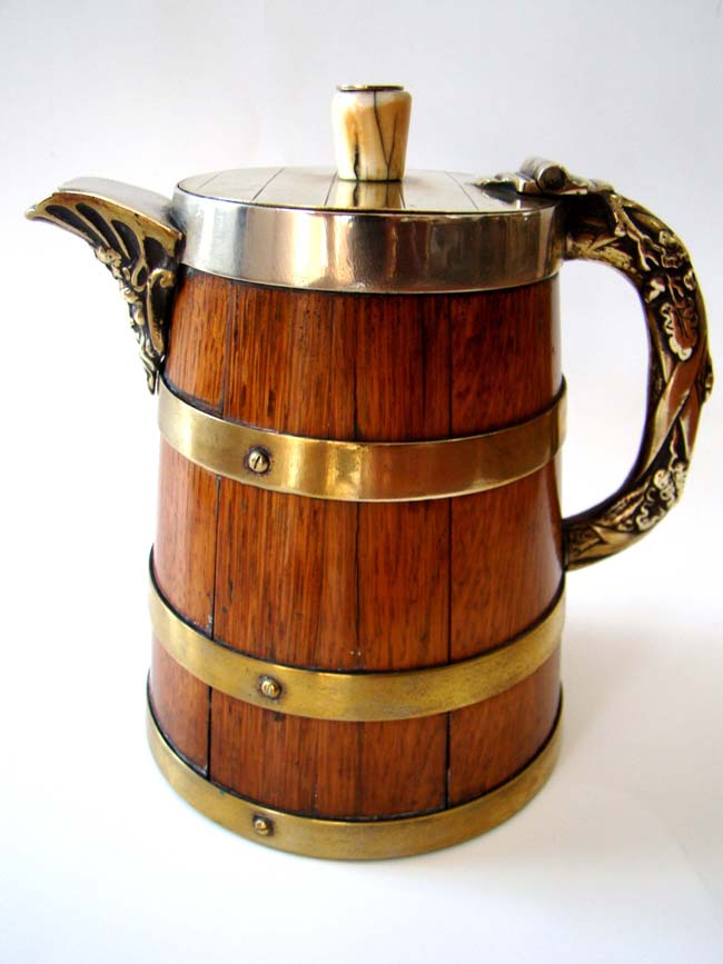 click to view larger image of A Victorian brass bound oak Beer Tankard circa 1870