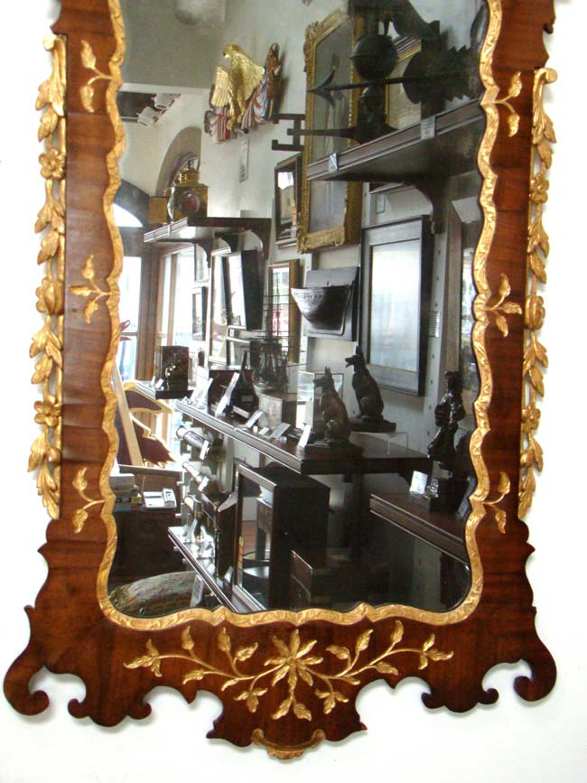 click to view larger image of An attractive George II period Walnut and Parcel-gilt mirror circa 1750