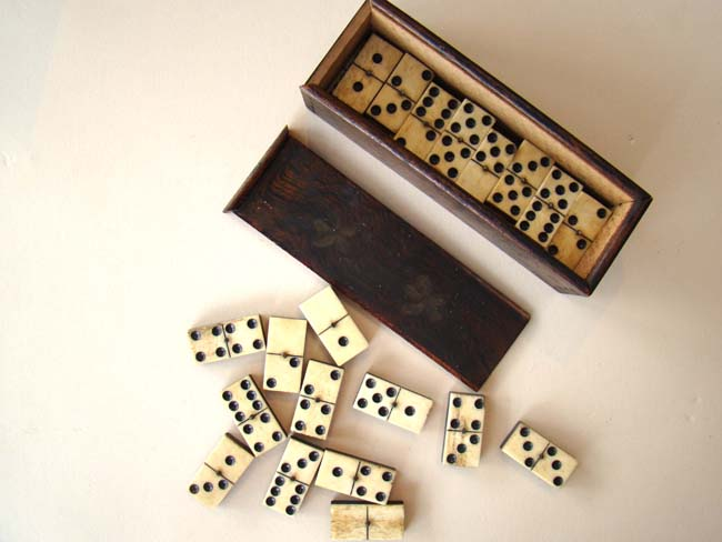 click to view larger image of A fine set of Civil War era bone and ebony dominoes circa 1865