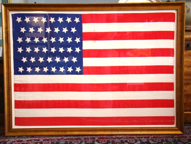 click to view larger image of A beautiful circa 1908 American flag with 46 stars in the 'dancing stars' pattern