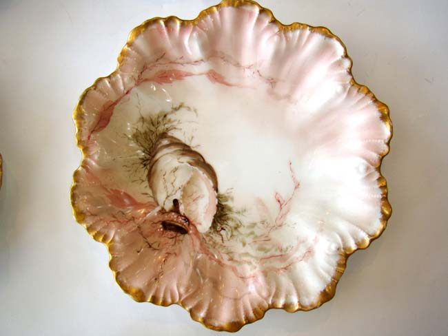 click to view larger image of A fine and rare set of four vintage hand-painted Limoges bone china shell and flora plates circa 189