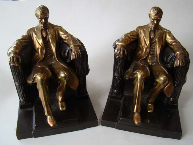 click to view larger image of A pair of Abraham Lincoln 'sitting in the chair' bookends by the Philadelphia Manufacturing Company circa 1935