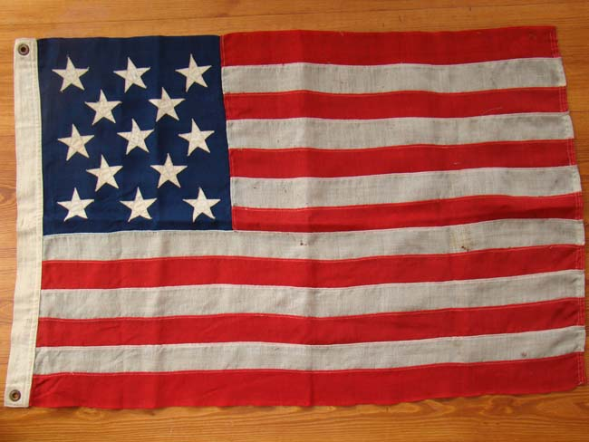 click to view larger image of A hand stitched woolen flag made for the Centennial in 1876