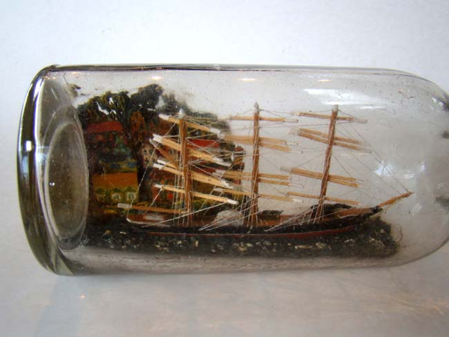 click to view larger image of A late 19th or early 20th century ship in a bottle