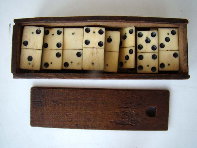 click to view larger image of A cased set of bone and ebony Dominoes circa 1860-1880