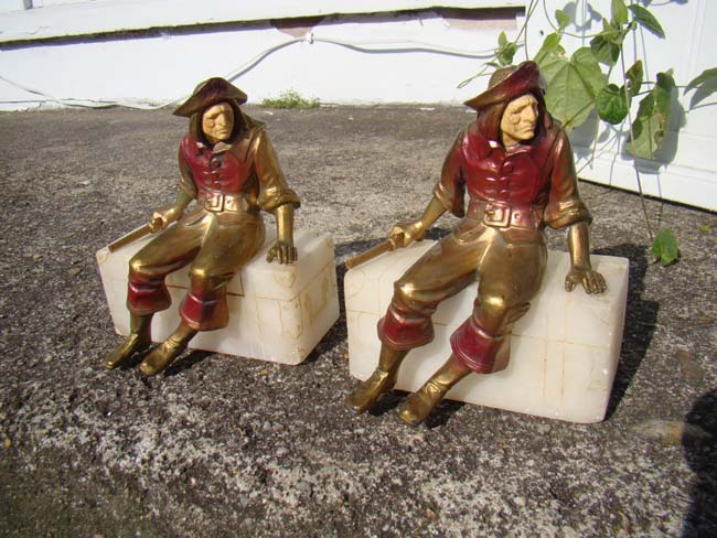 click to view larger image of A charming pair of Pirate sitting on a treasure chest bookends circa 1928