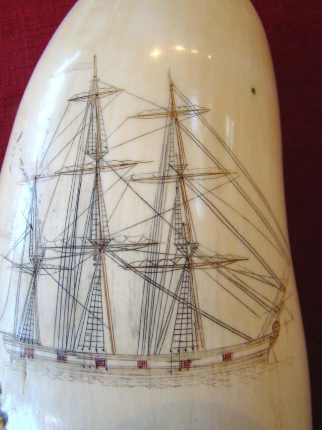 click to view larger image of A fine polycrome Scrimshaw whale's tooth depicting a three-masted warship circa 1850