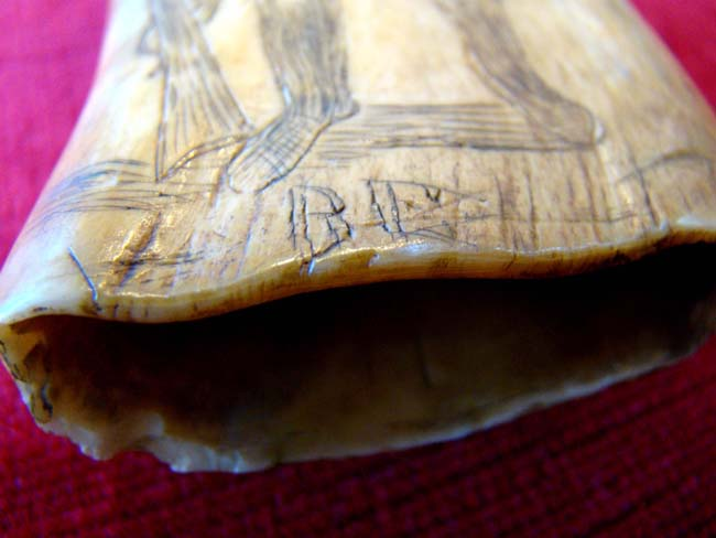 click to view larger image of A 19th century Scrimshaw whale's tooth depicting a Frontiersman holding a Kentucky rifle circa 1858