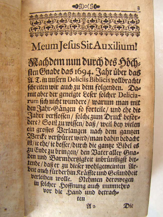 click to view larger image of A 17th century vellum bound German Bible printed in 1695 and in near 'unused' condition
