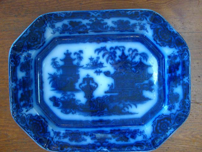 click to view larger image of A very rare early FLOW BLUE platter in the TEMPLE pattern by Podmore Walker & Co., circa 1834-1849