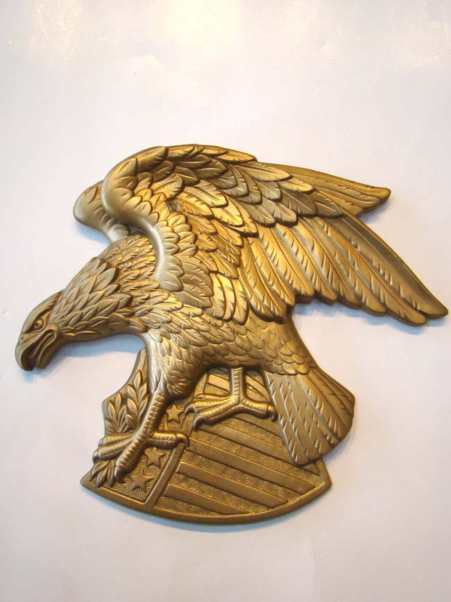 click to view larger image of A cast plaster American eagle plaque by Miller Studios 1969