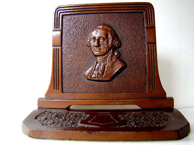 click to view larger image of A fine pair of antique bookends circa 1930 depicting George Washington made by Judd Manufacturing