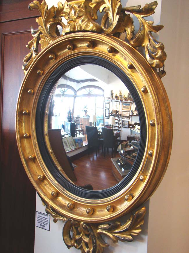 click to view larger image of An English Regency Giltwood Convex Mirror circa 1810-1820