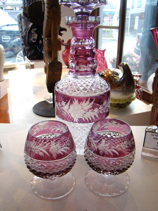 click to view larger image of A fine Amethyst cut crystal diamond point decanter with two matching cordial glasses