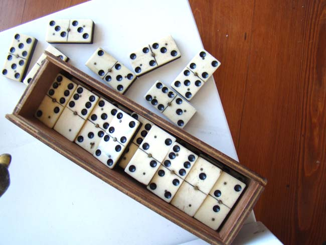 click to view larger image of A boxed set of 28 bone and ebony dominoes from the Civil War period circa 1865
