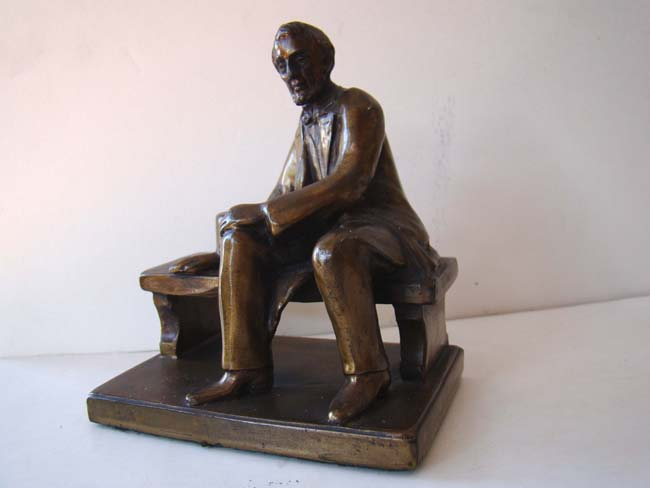 click to view larger image of A nice small pair of bronze bookends circa 1935 depicting Abraham Lincoln sitting on a bench