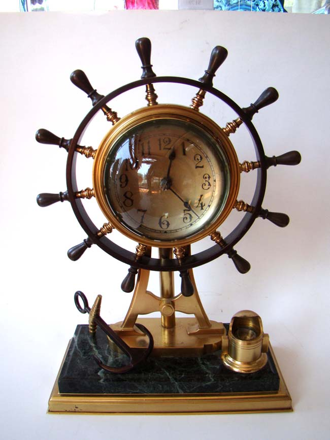 click to view larger image of A fine bronze ship's helm clock made in France circa 1895