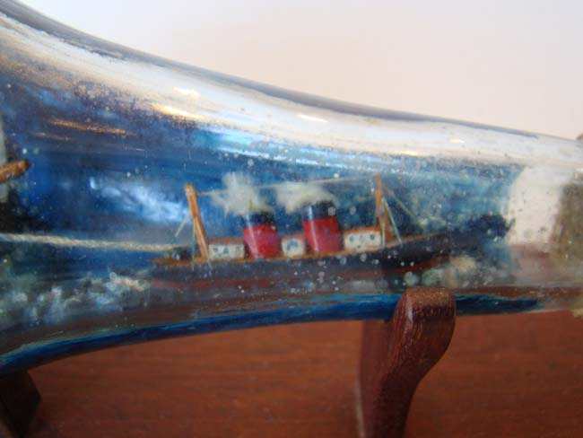 click to view larger image of A fabulous late 19th or early 20th century Ship-in-a bottle diorama