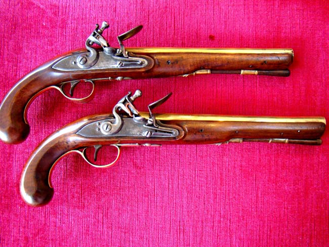 click to view larger image of A fine pair of late 18th century brass barreled