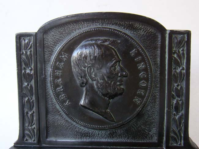click to view larger image of An attractive and rare pair of Abraham Lincoln profile bookends made by L.V. Aronson in 1921