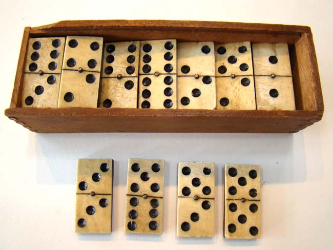 click to view larger image of A complete set of 28 Civil War era bone& ebony dominoes circa 1865