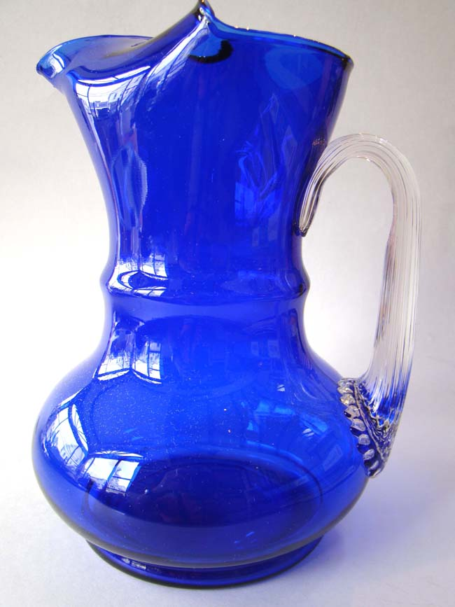 click to view larger image of A fabulous vintage colbalt blue glass pitcher