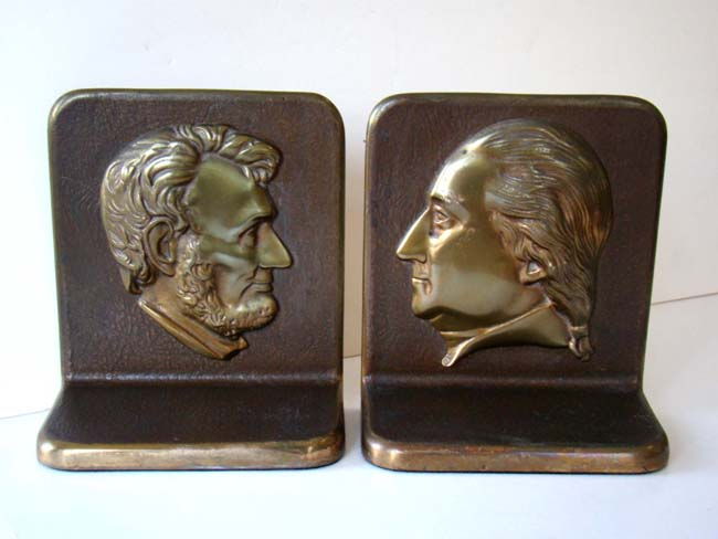 click to view larger image of A fine pair of solid bronze Presidential Bookends circa 1930 with the profiles of Abraham Lincoln and George Washington.