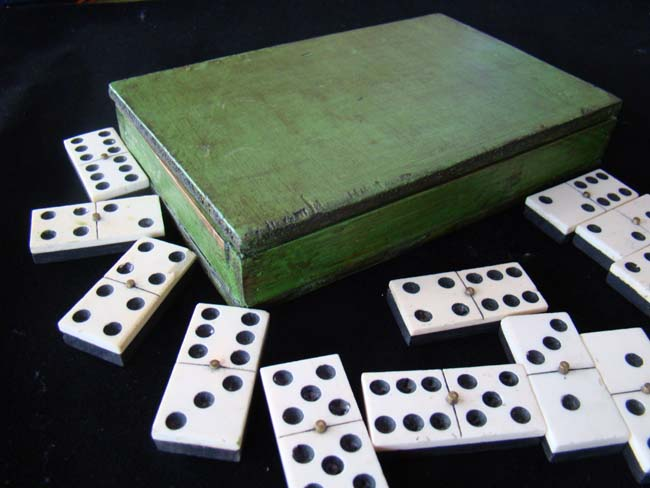 click to view larger image of A cased set of 19th century bone and ebony dominoes