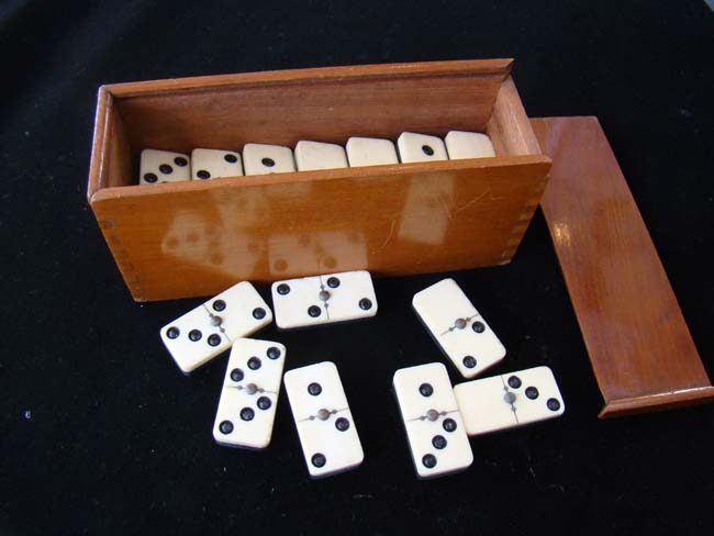 click to view larger image of A late 19th century boxed set of bone and ebony dominoes
