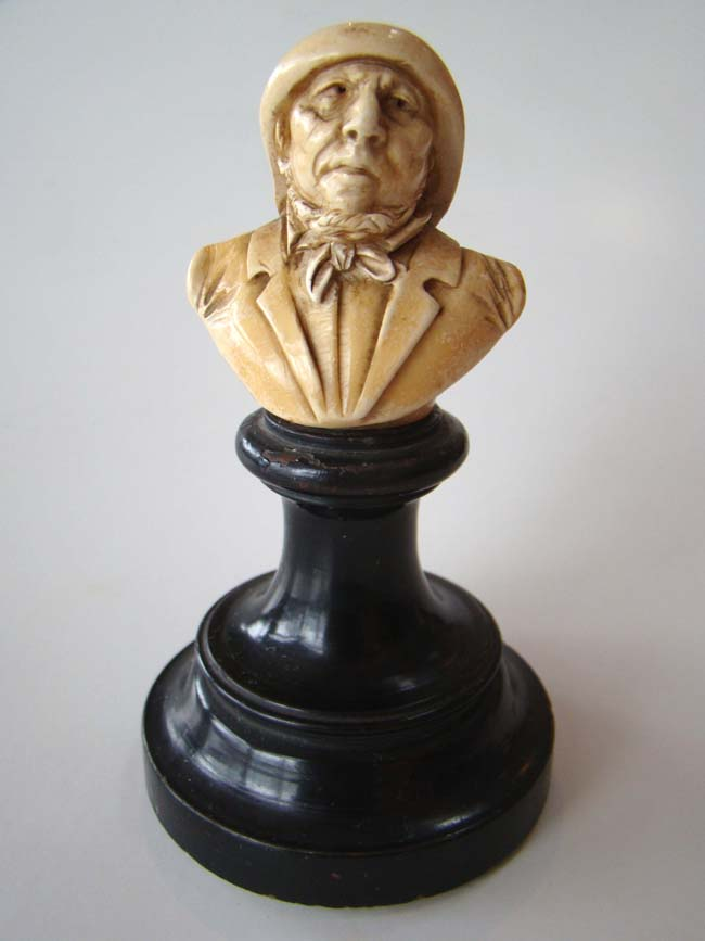 click to view larger image of A small and charming ivory bust of a gentleman mounted on a stand circa 1880