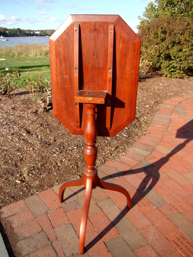 click to view larger image of A fine late 18th century Hepplewhite cherry tilt-top candle stand on spider legs circa 1790