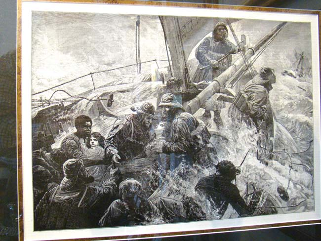 click to view larger image of A late 19th or early 20th century print depicting women and children being rescued from a sinking ship