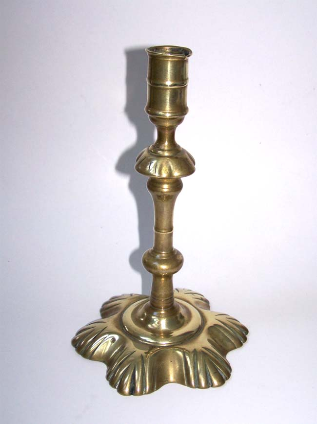 click to view larger image of An English Georgian period Brass Petal Base Candlestick circa 1750
